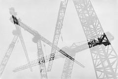 Cranes (double exposure) (JamieDieu) Tags: 35mmfilm blackandwhite ilford dslrscan om2