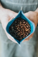 person holding coffee beans in pack - Credit to https://myfriendscoffee.com/ (John Beans) Tags: coffee coffeebean brown packet cafe coffeebeans shopbeans espresso coffeecup cup drink