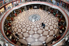 Passing Through (Karen_Chappell) Tags: travel architecture city people building wideangle circle geometry geometric fisheye canonef815mmf4lfisheyeusm floor interior usa illinois chicago pattern round design