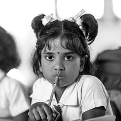 Taking a test (Henrik Ladegaard-Pedersen) Tags: girl school thinking srilanka blackandwhite test monochrome thoughful