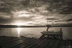 Docked (BobbyFerkovich) Tags: bristolsunsetrentonwashingtonlakewashington monochrome boat water clouds dusk twilight