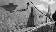 Prague street (Lilith di Mons-Cutnis) Tags: prague outdoor beautiful wall photooftheday czechrepublic czech picoftheday nooks amazing amazingplaces lamps lamp czecharchitecture lightandshadows shadows light monochrome bw blackandwhite novysvet novýsvět prag praha