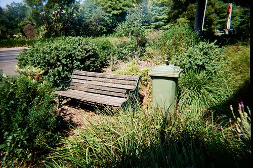 A bench and a rubbish bin