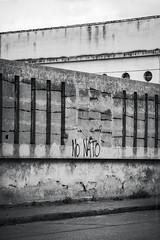 (Laura Sergiampietri) Tags: bn architecture urban bw biancoenero blackwhite lines peoplessness concrete geometric geometry wall writing graffiti old broken nonato written cracks fissures smcpentaxda1770mmf4alifsdm smcpda1770mmf4alifsdm