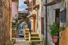 Calcata, Central Italy (Claudio_R_1973) Tags: calcata tuscia centralitaly lazio landscape street color architecture strange weird antique medieval old road lane arch stairs wall village outdoor