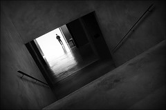 waiting for the end (bostankorkulugu) Tags: square door reflection shadow fashion light steps stairs architecture man walk guard security dark tilted tilt museum italia italy lombardia lombardy milano milan armanisilos silos armani