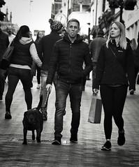 Dog Walk (Bury Gardener) Tags: monochrome mono bw blackandwhite burystedmunds britain suffolk streetphotography street streetcandids strangers candid candids 2018 nikond7200 nikon england eastanglia uk people peoplewatching folks abbeygatestreet