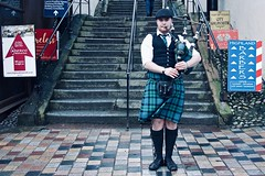 Street musician. (Livia Lopez) Tags: photography stairs bagpipes musician street man scotland kilt inverness