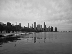 Lakefront (ancientlives) Tags: chicago illinois il usa travel trips lakemichigan lakefronttrail lakeshore lake city cityscape skyline skyscrapers sky clouds downtown reflections snow ice weather saturday february 2019 winter mono monochrome blackandwhite bw towers architecture buildings