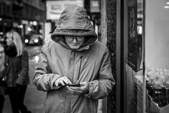 Touchscreen (Leanne Boulton) Tags: portrait urban street candid portraiture streetphotography candidstreetphotography candidportrait streetportrait streetlife man male old elderly face expression mood eyes glasses reflection mobile phone smartphone screen hood tone texture detail depthoffield bokeh naturallight outdoor light shade city scene human life living humanity society culture lifestyle people canon canon5dmkiii 50mm primelens ef50mmf14usm black white blackwhite bw mono blackandwhite monochrome glasgow scotland uk