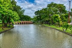Lake and bridge in Chatuchak park, Bangkok, Thailand (UweBKK (α 77 on )) Tags: lake bridge tree grass green clouds sky grey chatuchak jatujak park bangkok thailand southeast asia sony alpha 77 slt dslr
