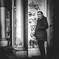 (Mister G.C.) Tags: blackandwhite bw sonya6000 sonyalpha6000 mirrorless streetphotography urbanphotography candid street monochrome photograph image people woman lady female eyecontact graffiti gritty unposed urban town city sony a6000 35mmf18 sel35f18 35mm primelens schwarzweiss strassenfotografie glasgow scotland europe
