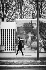 Streets of... Grenoble #59 (richardtostain) Tags: street rue black bw blackwhite noir nb noirblanc reflection reflet notes musique music sound bokeh walk canon fd 85mm f12 l sony a7ii