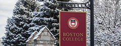 The main gates in winter. (BostonCollegeFlickr) Tags: campus commonwealthavenue entrance exterior maingates seasons sign signage snow winter