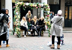 Garlands for the girls (Peter Denton) Tags: coventgarden girls women smiles garland flowers street candid ©peterdenton canoneos100d england uk capitalcity smile