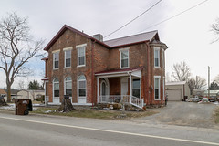 House — Butlerville, Ohio (Pythaglio) Tags: house dwelling residence historic building structure cruciform commonbond brick twostory italianate butlerville ohio warrencounty stone lintels sills 11windows roundarched doorway sidelights porch altered brackets polygonalbay