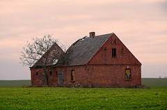 A lonely and abandoned house (elzbietafazel) Tags: ruin devastated rural landscape field farm brick buildingexterior grass abandoned lowland dilapidated countryside scene hovel detachedhouse poland village bierzglowo