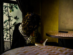 Still life with girl, book, plant and mobile phone (Eskay Pics) Tags: girl book plant table bar street streetlife city citylife urban