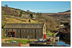 Postcard from the 'edge (david.hayes77) Tags: huddersfieldnarrowcanal marsden westyorkshire freightliner class66 shed 66604 freight cargo tanks cement moorland standedgetunnel standedge winter 2019 6m22 warehouse colnevalley standedgetunnelvisitorcentre watersroad yorkshirebeauty postcard landscape britishwaterways barge boat cottages houses pennines moors godsowncountry pasture