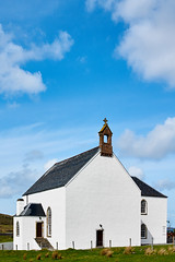 Church of Scotland, Kensaleyre, Isle of Skye, Scotland (imagesbyhmck) Tags: door doorway woodendoor roof stairs stonestairs archedwindow belltower chapel church placeofprayer placeofworship prayer religion religious reverence rite ritual spiritual veneration worship spirituality theology churchofscotlandkensaleyre snizortparishchurch christianity building whitewalls whitewashed slate slateroof stonewalls clean calm peace peaceful tranquil tranquility may 2009 eu unitedkingdom britain gb gbr greatbritain scotland scottishislands hebrides innerhebrides skye isleofskye kensaleyre uk christian naheileananastaigh window