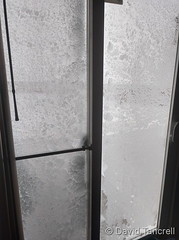 March 13, 2019 - Blown snow covers a sliding door in Thornton. (David Tancrell)