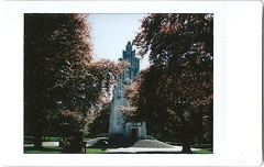 ix-war memorial behind the trees (johnnytakespictures) Tags: fuji fujifilm instax mini 8 eight instaxmini film fujiinstaxmini instantfilm polaroid analogue 300 expired expiredfilm coventry godiva memorial park monument war summer sun sunshine dedication tower tree trees gardens nature natural architecture