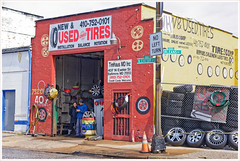 2019/052: Used Tires (Rex Block) Tags: 2019052usedtires nikon d750 dslr 85mm f18g baltimore maryland store garage repair car front tire shop owner couple red bricks project365 365the2019edition 3652019 day52365 21feb19