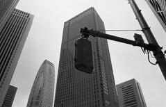 Skyscrapers (Manuel Goncalves) Tags: tokyo shinjuku orientalseagull400 nikonn90s nikkor28mm analogue blackandwhite 35mmfilm street urban city japan