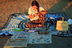 Seawall Sales (HereInVancouver) Tags: candid sales seawall grass park blanket jewelry homemade urban city vancouverswestend canong3x sunsetlight thingstodobythewater youngwoman vancouver bc canada