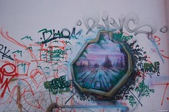 IMGP4807 Imagination behind a wall (Claudio e Lucia Images around the world) Tags: alzaianavigliogrande milano murales murale decoration graffiti streetart naviglio navigli navigliogrande colors art pentax pentaxk3ii sigma sigma1020 strada insegna cielo muro