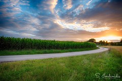 Road to Heaven (Stathis Iordanidis) Tags: courves countryside landscape greencolor farm farmland grassland grass dramaticsky dramaticclouds path road sun sundown sunset