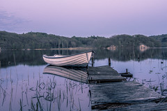 Untold stories part 3 (Fredrik Lindedal) Tags: boat jetty reflection reflections reed lake landscape sky skyline forest calmness silence sweden sverige lindedal