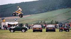Gala day entertainment (M McBey) Tags: scotland dallas gala stunt kangarookid guinnessrecord jump display flying village nikkormatftn 50mmf20ai kodachrome