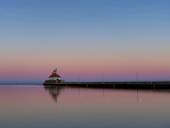 A Slight Tinge of Spring at Sunset (rbodgers) Tags: reflection gradient canal winter spring lighthouse sunset water lake duluth lakesuperior shotoniphone