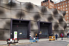 Woven steel wire façade - health science centre, Guy's Hospital, Southwark, London SE1 .. (edk7) Tags: olympusomdem5 edk7 2017 uk england london londonboroughofsouthwark londonse1 guysandstthomasnhsfoundationtrust guyshospital hospital kingshealthpartnersacademichealthsciencecentre industrial engineering mechanical wovensteelwire city cityscape urban architecture building oldstructure façade door people street sidewalk pavement safetybarrier