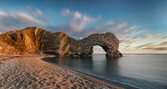 Durdle door (paullangton) Tags: durdledoor jurassic coast coastal sea sky clouds water rocks dorset blue beach warm tone