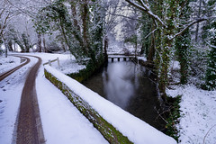 Wiltshire Snow - winters morning on River Ebble, Bishopstone (cantdoworse) Tags: landscape wiltshire england river ebble bishopstone snow bridge trees countryside road winter tracks long exposure a7riii sony