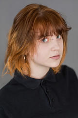 Intriguing eyes (piotr_szymanek) Tags: michalina woman young portrait studio face eyesoncamera redhead black piercing nosepiercing eyebrowpiercing lipspiercing 1k 20f 50f 5k 10k