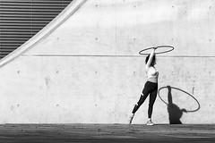 Hula Hoop (Leipzig_trifft_Wien) Tags: berlin deutschland de fun training black white circle sport person people street urban bnw blackandwhite monochrome light shadow shadowplay streetphoto