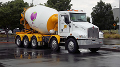 Wet Cement (Jungle Jack Movements (ferroequinologist)) Tags: elvin group rise above cancer convoy majura park airport canberra act australia australian capital territory kenworth t359 cement concrete mixer agitator blender screen rain reflect tri axle bogie hp horsepower big rig haul haulage freight trucker drive transport carry delivery bulk lorry hgv wagon road highway nose trailer cargo vehicle load freighter ship move roll motor engine power teamster truck tractor prime mover diesel injected driver cabin loud rumble beast wheel exhaust grunt twin steer