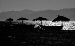[ Spettinati - Messy ] DSC_0685.R2.jinkoll (jinkoll) Tags: sea reflections water mare waves wind windy umbrellas sicily strait messina reggio calabria silhouettes boats beach sand contrast four silver blackandwhite bnw bn bw seascape