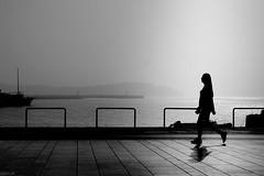 ---i- (heinzkren) Tags: schwarzweis blackandwhite bw sw monochrome panasonic lumix wharf woman kai sea meer human geometry street streetphotography candid silhouette light shadow quay istrien rovinj hr fog nebel frau promenade
