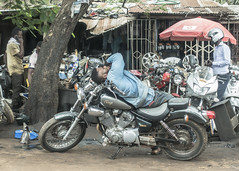 the man and his bike (andreasbrink) Tags: africa ghana people urban street streetphotography accra motorbike