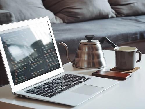 turned on MacBook Air beside black smartphone and black ceramic mug - Credit to https://myfriendscoffee.com/
