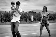 Enough (Beegee49) Tags: street family man father carrying child mother filipina blackandwhite monochrome happy planet sony a6000 bw luminar silay city philippines