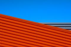 Play with orange and grey lines (Jan van der Wolf) Tags: 18820vgreygrijsoranjeorangelineslijnenlijnenspelinterplay linesplay lines gevel gebouw geometric geometry geometrisch geometrie simple simpel minimalism minimalistic minimalisme minimal minimlistic