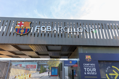 """FC Barcelona logo at the entrance of Europe's largest football stadium """"Camp Nou"""",next to its Museum in Spain"""