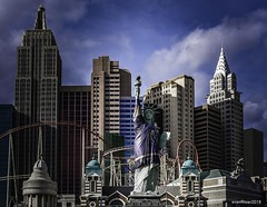 Iconic Skyline (evanffitzer) Tags: vegas lasvegas skyline newyorknewyork city fujix100s fujifilmx100s hockey uniform evanfitzer evanffitzer photography photographer sky buildings skyscraper knights statue facade