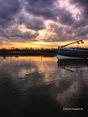 Refelection Breaker (iPhone Fotograaf) Tags: sun landscape river sunset clouds evening sky reflection ship water boat iphone8plus