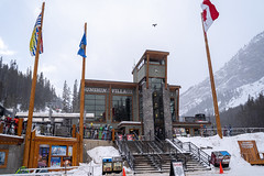 Banff, Alberta Canada - Janurary 19, 2019: Sunshine Village ski area, view of the lodge chalet. Taken during a snowstorm (m01229) Tags: ssnowboard sunshinebanff flag calm nature altitude gondola sunshinevillage skibanff snow banffnationalpark busy banff outdoors canada banffski canadianrockies mountaineering lifestyles landscape winter cloudy nationalpark mountains cold adventure northamerica beautiful travel alberta rockymountains loading ski blowing people skilift mountain